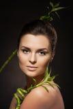 Girl with bamboo sticks Stock Photos