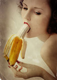 Girl with banana Royalty Free Stock Image