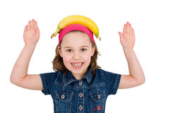Girl with a banana on his head Stock Images
