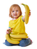 Girl with banana isolated on white Stock Images