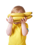 Girl with banana isolated on white Stock Photos