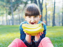 Girl with banana Royalty Free Stock Images