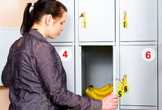 Girl with bananas in the safe Royalty Free Stock Photo