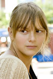 Girl with bangs. Portrait of a teenage girl with blond hair and bangs stock photography