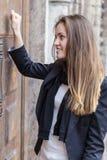 Girl bangs in a closed door Royalty Free Stock Photo