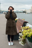 Girl on the bank of Moscow-river. Covering her face with scaf stock photo