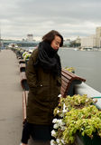 Girl on the bank of Moscow-river Royalty Free Stock Image