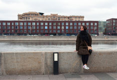 Girl on the bank of Moskcow-river. Girl on the bank of Moscow-river in Moscow of Russia royalty free stock photos