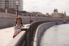 Girl on bank of the river Stock Photo