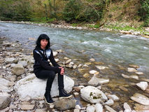 The girl on the bank of the river, Caucasus Nature Reserve Royalty Free Stock Images