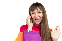 Girl with banking credit card, colorful shopping paper bags, sma. Young woman with banking credit card, colourful shopping paper bags and packages, smartphone Royalty Free Stock Images