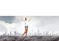 Girl with banner Stock Images