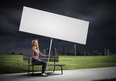 Girl with banner Royalty Free Stock Images