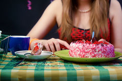 Girl at the banquet table Stock Photography