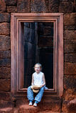 Girl in Banteay Srei temple Stock Photo