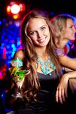 Girl in bar Stock Images
