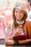 Girl in a bar Royalty Free Stock Photo