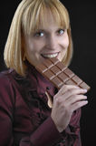 Girl with a bar of chocolate Royalty Free Stock Photo
