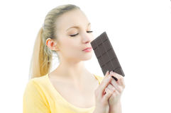 Girl with bar of chocolate Stock Images
