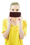 Girl with bar of chocolate Royalty Free Stock Image