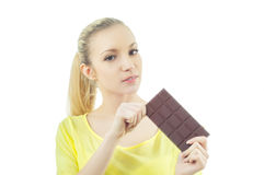 Girl with bar of chocolate Stock Photography
