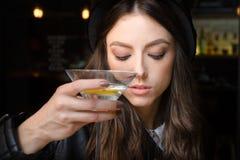 Girl in bar. Girl drinkinig alcohol in bar Royalty Free Stock Photography