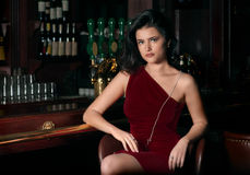 Girl at a bar, fullfaced picture Royalty Free Stock Photo