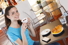 Girl at the bar having coffee break with cappuccino Royalty Free Stock Photos