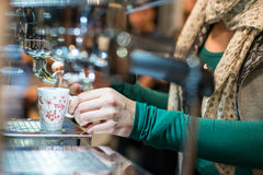 Girl at the bar prepares espresso Stock Photography