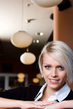 Girl in a bar Royalty Free Stock Image