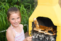 Girl while a barbecue Royalty Free Stock Photo