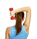 Girl with barbell Stock Images