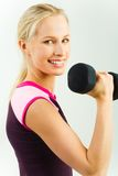 Girl with barbell Stock Photo