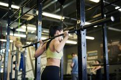 Girl with barbell stock image