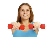 Girl with barbells Royalty Free Stock Image