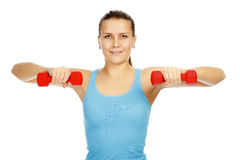 Girl with barbells Stock Image