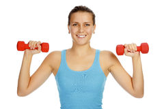 Girl with barbells Royalty Free Stock Photography