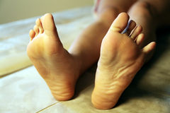Girl bare feet. Girl lying down alone barefoot Stock Images