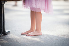 Girl bare feet on the ground Royalty Free Stock Images