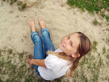 Girl with bare feet in the sand Royalty Free Stock Photography