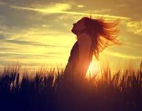 Girl in a barley field Stock Photos