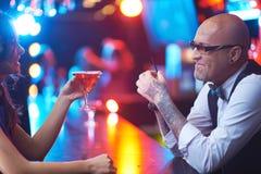 Girl and barman Stock Images