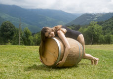 A girl on a barrel 3 Royalty Free Stock Photos