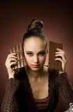 Girl with bars of chocolate Stock Images