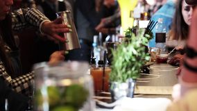 Girl bartender making drinks in bar. MOSCOW, RUSSIA - SEPTEMBER 09, 2015: Girl bartender making cocktail drinks in bar close up process stock video