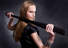 Girl with the baseball bat. Fashion girl with the baseball bat royalty free stock photos