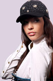 Girl in a baseball cap Royalty Free Stock Photos