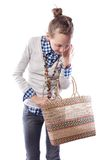 Girl with a basket. Young girl with a basket Royalty Free Stock Photos