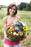 Girl with a basket stock photos