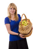 Girl with a basket of apples. Royalty Free Stock Images